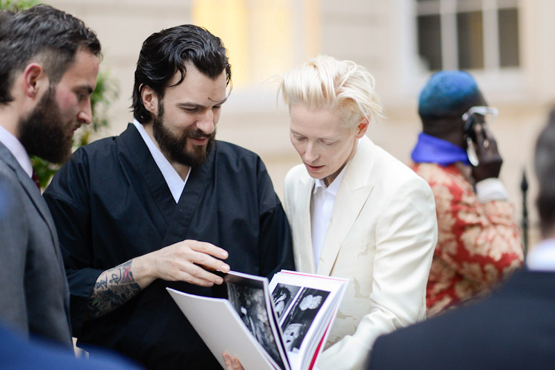 London Fashion week Horiyoshi3 event. Tilda Swinton gets a Kokoro book from Kofuu-Senju Publications..